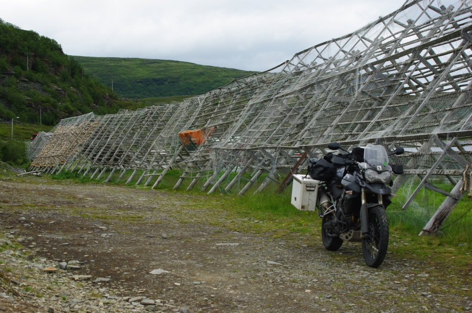 My riding buddy Jon captured this image on our way from the North Cape. He really wanted a pic with his Triumph in front of these racks that is used to dry fish. An Image of Norway. Photo: Jon Whitmore